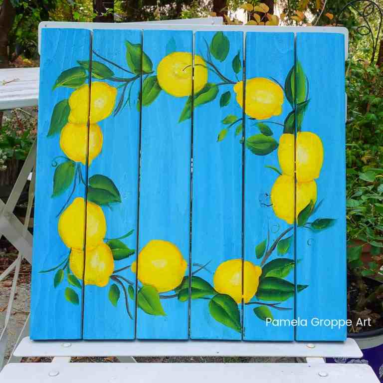Wreath of Lemons painted on a pallet board, with a beautiful blue background