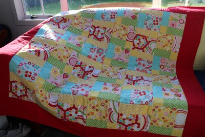 I have fast tracked the project. If you want to see how to put the wadding and backing material onto the patchwork, you can look at my previous blog post. I did do one thing different this time though... As it was a larger blanket, I used fabric spray on glue to help hold the materials together. It washes out and causes no long term damage to the blanket, but it certainly makes life a whole lot easier when it comes to the top stitching :-)