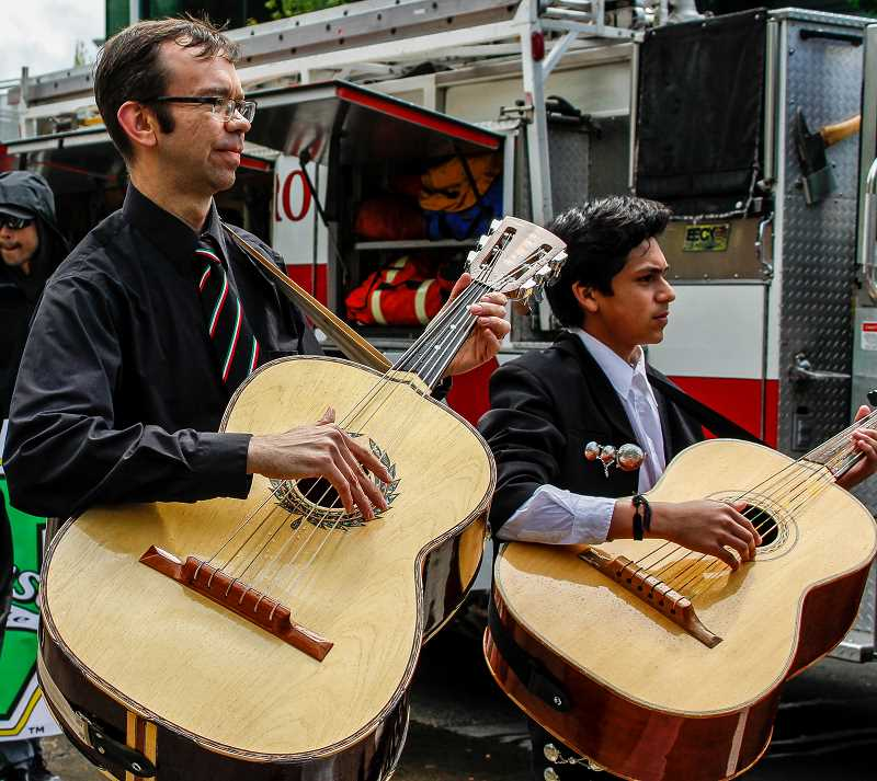 HILLSBORO TRIBUNE PHOTO: TRAVIS LOOSE - Lincoln Elementary music Teacher Dan Bosshardt (left) plays the guitarrÍn in the Latino Cultural Festival alongside the mariachi group Unz Voz.