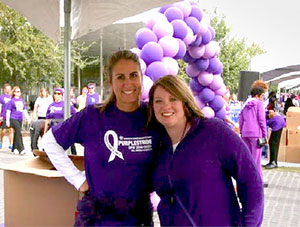 PurpleStride Chair Sonya Martin (right) and Team Captain Katie Bloom celebrate the results of their efforts to organize the 2014 PurpleStride Dallas - Fort Worth.