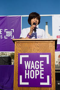 Three-year survivor Lupe Romero speaks about her pancreatic cancer journey at the PurpleStride Los Angeles event