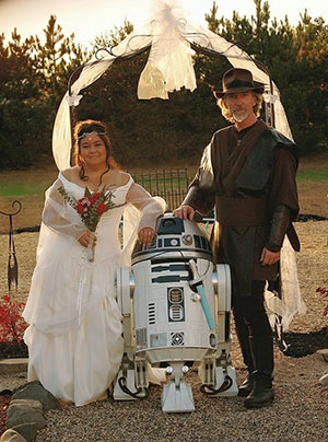 Kevin Doyle and his wife, Eileen, with ring bearer R2-D2 on their wedding day in October of 2009.