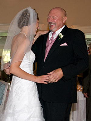 Bryant dancing with her father on her wedding day.