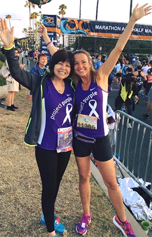 Lupe (left) and friend Julie Weiss feeling victorious after completing a race.
