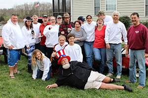 The polar plunge team gathers for a photo – cozy and warm in their sweatshirts – lakeside in Mineral, Virginia.