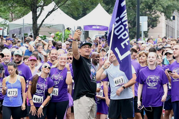 Coach Ron Rivera rallies participants before PurpleStride.