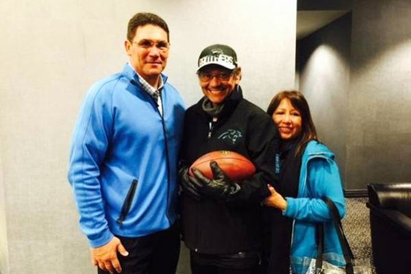 Ron Rivera with Mickey and Mickey's wife.