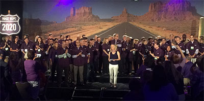 Grantees are celebrated on stage along with Julie Fleshman, JD, MBA, our president and CEO.