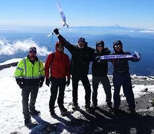 Joe with his nephews and friends summiting Mount Adams.