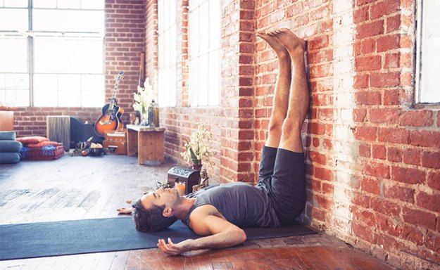 Yoga posture with legs up on a wall can aid in lymphatic drainage and generate energy