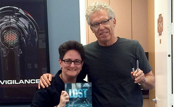 "Jo Garfein holds signed Lost collectible with the show's screenwriter with ""LOST"" Show Runner Carlton Cuse"