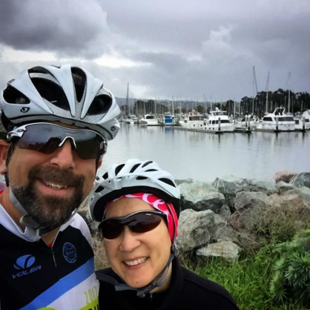 Long-term pancreatic cancer survivor and her husband wear bike helmets as part of her exercise