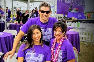 21-year pancreatic cancer survivor with her husband and daughter at 5K walk in San Diego.