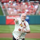 While battling pancreatic cancer, survivor throws first pitch at St. Louis Cardinals' game