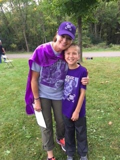 Pancreatic cancer 20-year survivor and a child at a bike/walk fundraiser event in Minnesota
