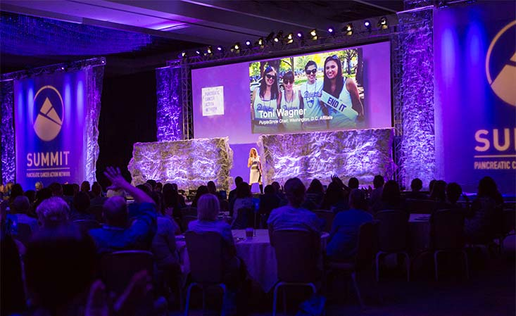 Attendees at PanCAN leadership and scientific meeting gather for a presentation.