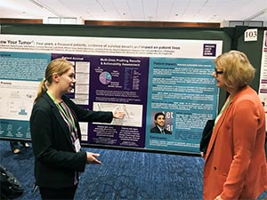 Two women discuss PanCAN's Know Your Tumor® precision medicine results at AACR conference.