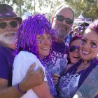 PurpleStride participants hug their teammate and pancreatic cancer survivor at the 5K walk.