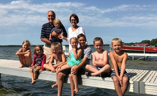 Pancreatic cancer survivor on a lake in Minnesota with his wife and grandchildren