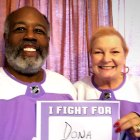 Husband and wife wearing Hockey Fights Cancer jerseys as she battles pancreatic cancer