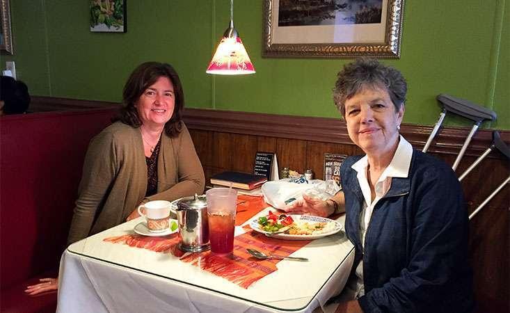 Pancreatic neuroendocrine tumor survivor enjoys dinner at a restaurant with a friend