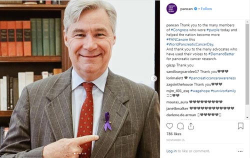 Congressman points to purple ribbon on his jacket in honor of World Pancreatic Cancer Day