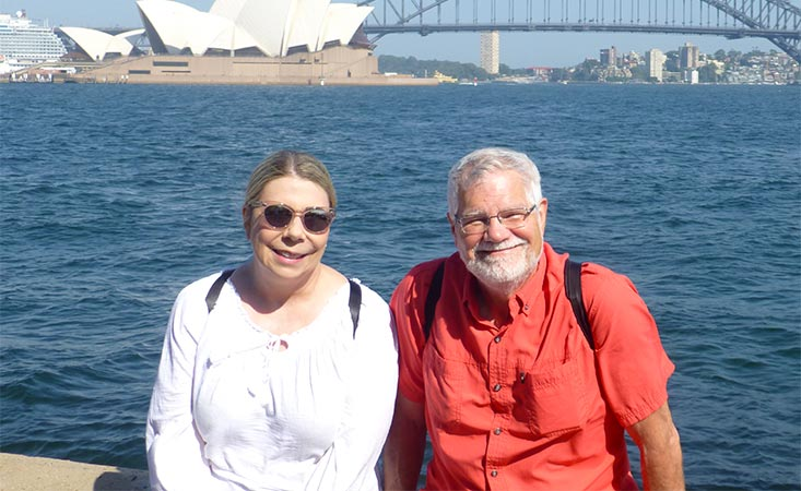 Pancreatic cancer survivor and his partner in front of the Sydney Opera House in Australia