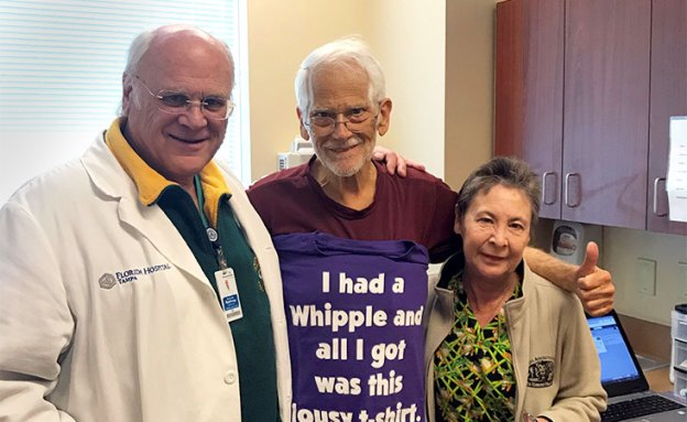 Pancreatic cancer patient and his wife stand with surgeon who performed his Whipple procedure