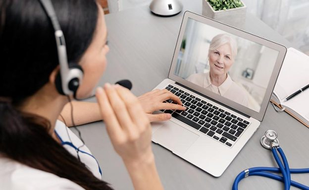 Pancreatic cancer patient has a telemedicine video phone call with her oncologist