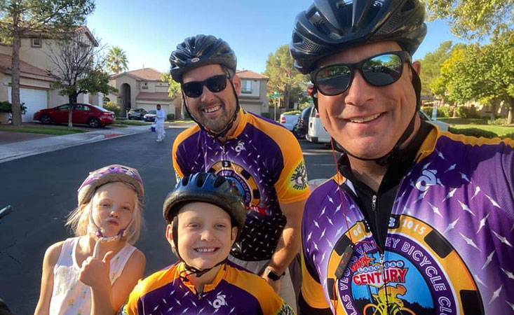 Males on bikes taking part of PurpleStride events..