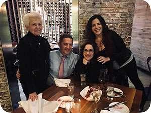 Pancreatic cancer survivor Susan Schultz with children, including caregiver Lauren, seated