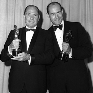 """Henry Mancini (right) and Johnny Mercer with their Best Song Oscars for """"Moon River."""""""
