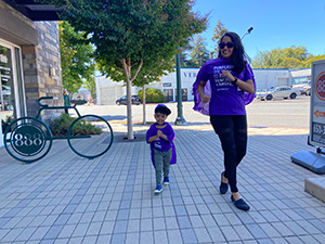 Woman and toddler walking in support of pancreatic cancer research.