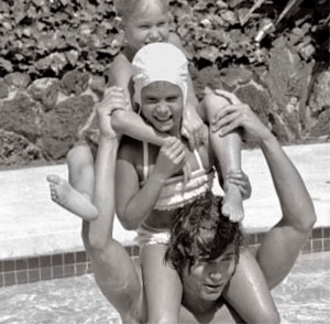 Michael Landon in an undated photo in pool with kids