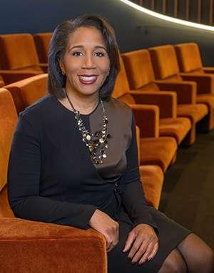 Headshot of professional, middle-aged Black female