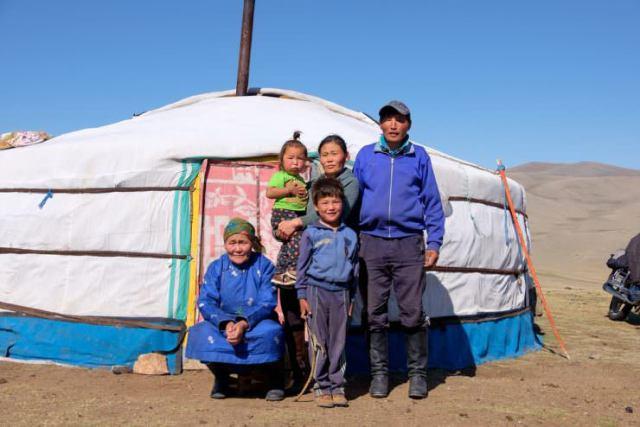 Mongolian family near Ger © Emily Marie Wilson | Shutterstock, Inc.
