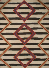 Southwestern Tribal Design. Ivory and Black with Multi Colored Accents area rug