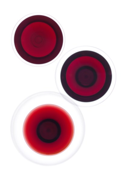 Wine glasses on a white background, from above
