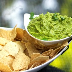 chips and guacamole in a tiered serving bowl