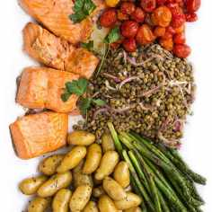 Best Mother's Day Brunch Recipes: Salmon Niçoise salad recipe is one of my favorites. It has tender cooked salmon, lentils, potatoes, asparagus, and roasted tomatoes. Each element is wonderful on it's own. Put them all together and you've got a gorgeous feast for lunch, brunch or dinner l www.panningtheglobe.com