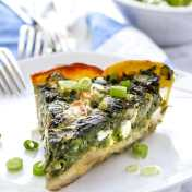 slice of Greek spinach pie in potato crust