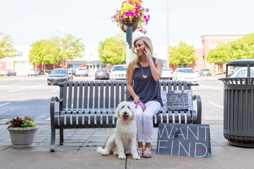 Woman with dog sitting on bench
