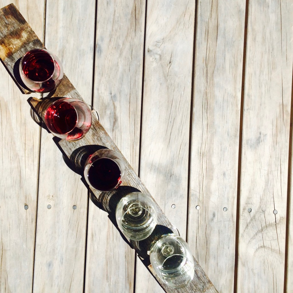 wine tasting flight on wooden plank