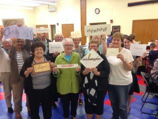 MAC members hold up calligraphy!