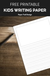 Lined writing paper with a drawing box on wood background with a pen with text overlay- free printable kids writing paper