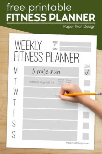 Free printable fitness planning page with hand holding pencil and text overlay- free printable fitness planner