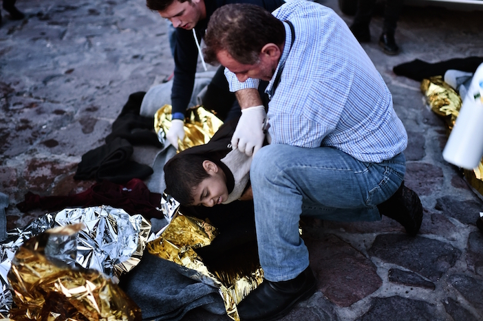 Doctors and paramedics try to revive a boy who has been taken to the hospital in a critical condition shortly after the rescue operation, after boat with refugees and migrants sunk while attempting to reach the Greek island of Lesvos