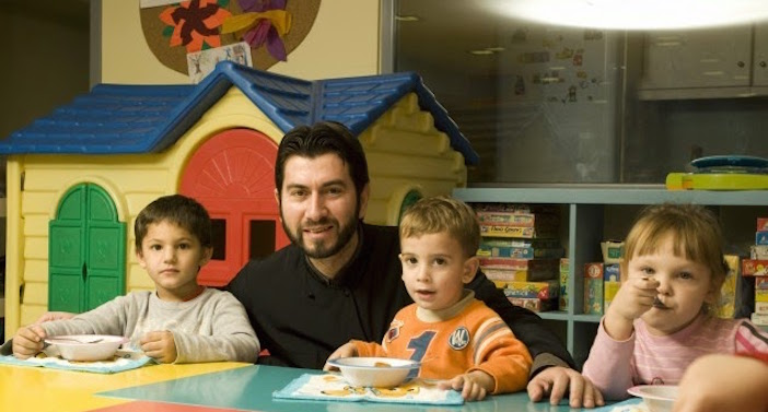 Fr. Antonios with children at Ark of the World