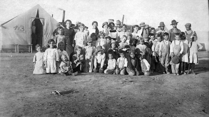 This 1914 photo provided by the Denver Public Library, Western History Collection, shows children and some adults posing for a photo at camp Ludlow in south central Colorado. (Denver Public Library, Western History Collection)
