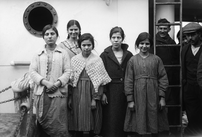 """New York, New York, USA --- 1/21/1921-New York, NY: """"Picture Brides"""" arrive from Greece to wed here--Five of the 300 """"Picture Brides"""" who arrived in New York the other day on the S.S. Megalli Hellas from Greece to marry Greek Americans. The majority had never seen their prospective husbands, their courtships having been carried on by mail and the exchange of photographs. Each of the brides-to-be carried photos of her future husband and each of the loving swains crowded about the ship with pictures of his prospective bride. In many cases these photographs were the sole means of identification. --- Image by © Bettmann/CORBIS"""